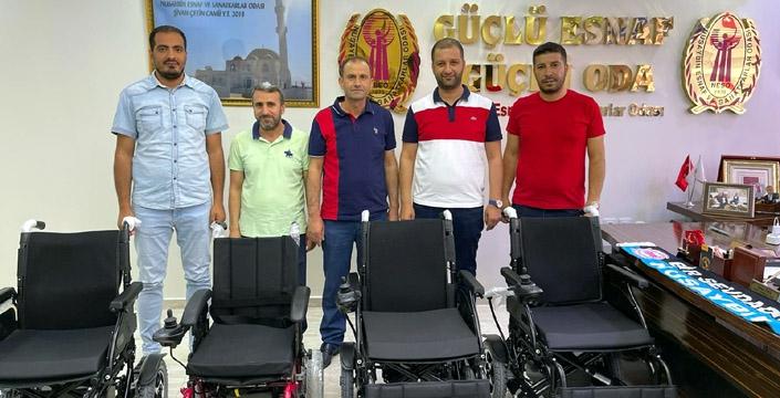 NESO tarafından engelli 4 vatandaş için akülü tekerlekli sandalye temin edildi